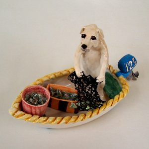 commission sculpture dog catching fish