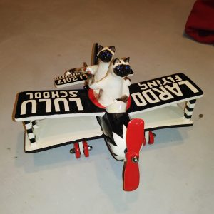 commission sculpture siamese cats flying airplane for lulu and lardo flying school