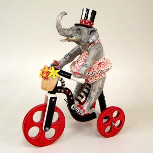 commission sculpture elephant riding tricycle