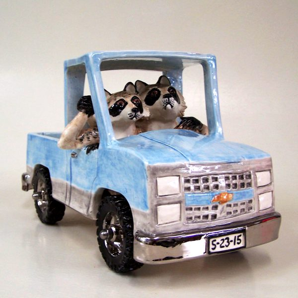 commission sculpture raccoons driving wedding truck