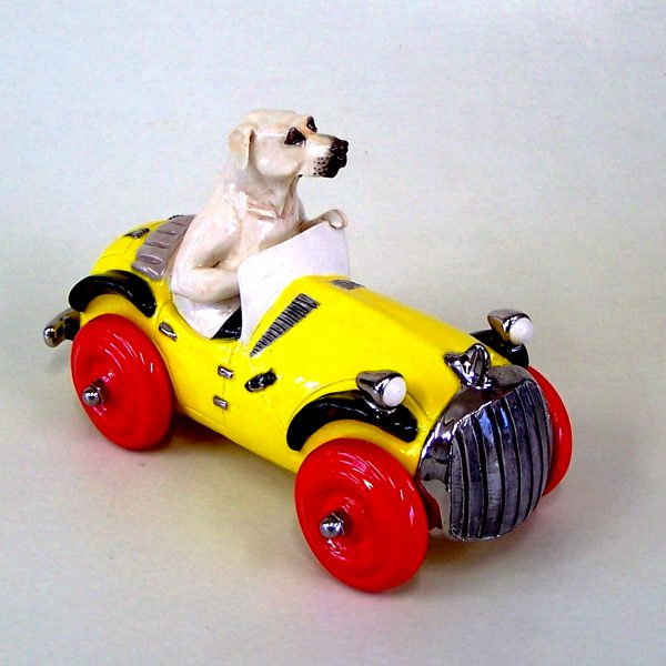 commission sculpture dog driving yellow car