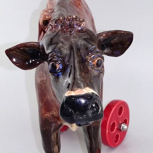 cow on wheels face