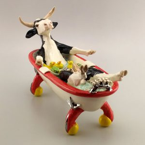 exotic clay sculpture cow in bathtub
