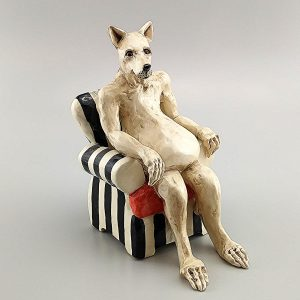 narrative clay sculpture anubis in chair