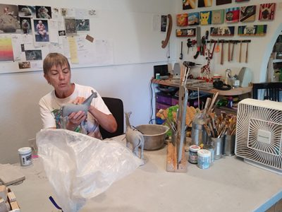 Andree creating whimsical zebras in her Tucson, Arizona clay art production studio