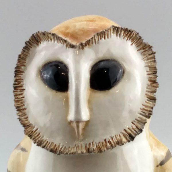 whimsical clay sculpture barn owl