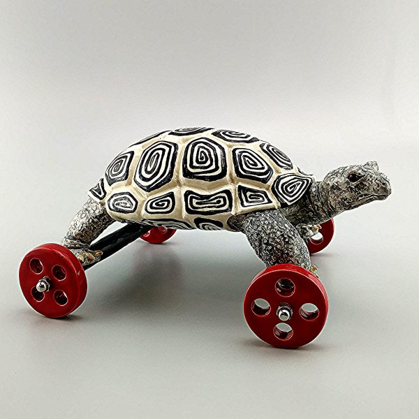 whimsical clay sculpture black and white tortoise