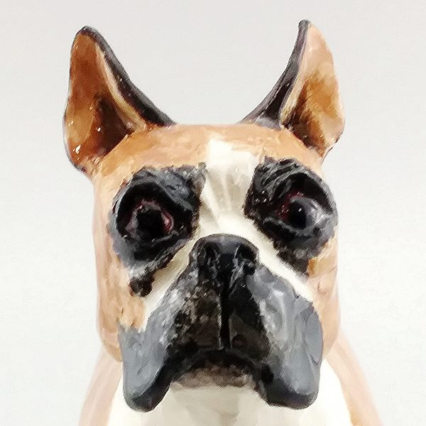 whimsical clay sculpture boxer