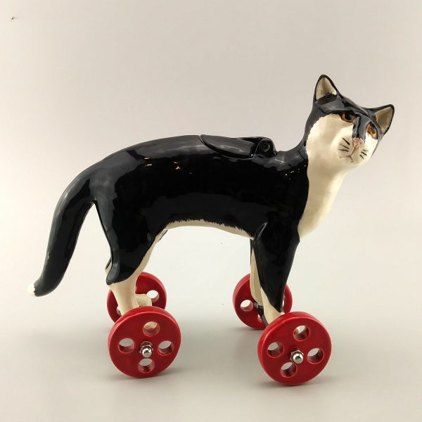 whimsical clay sculpture tuxedo cat
