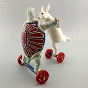 whimsical clay sculpture hare and tortoise