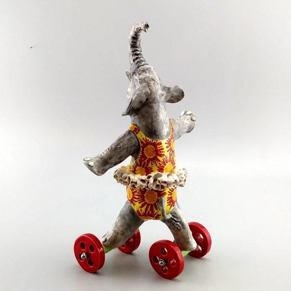 whimsical clay sculpture running elephant