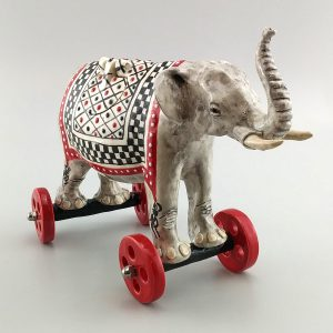 whimsical clay sculpture trunk up elephant