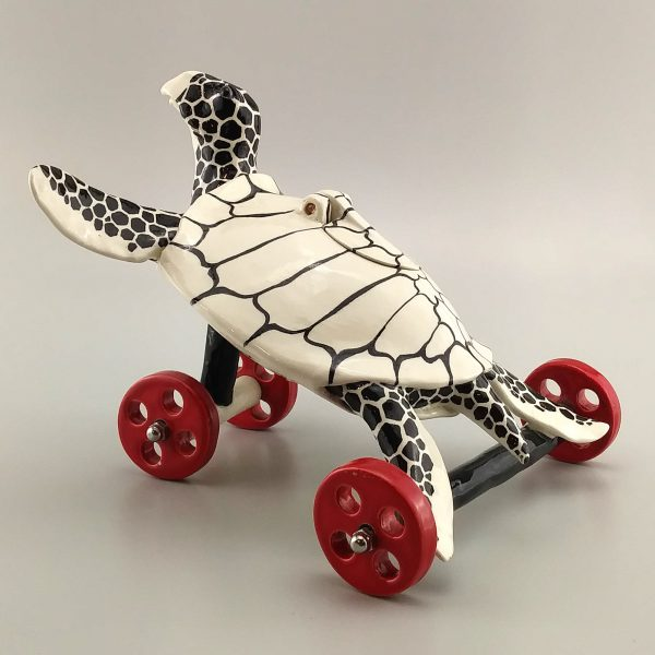 whimsical clay sculpture black and white sea turtle
