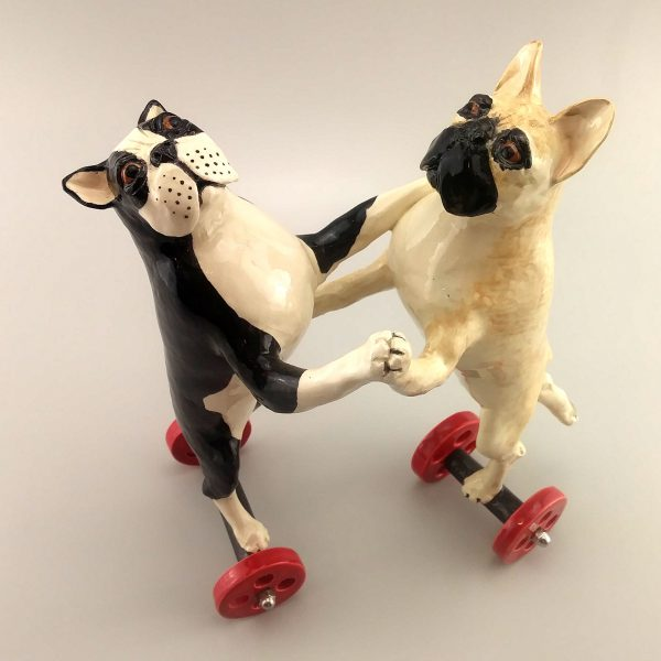 clay sculpture two pugs dancing