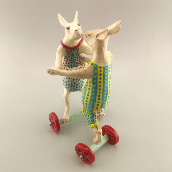 whimsical sculpture two rabbits dancing