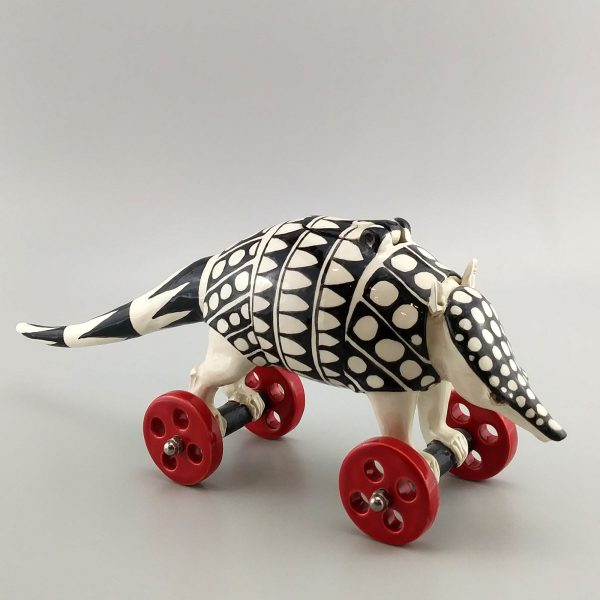 whimsical clay sculpture white armadillo